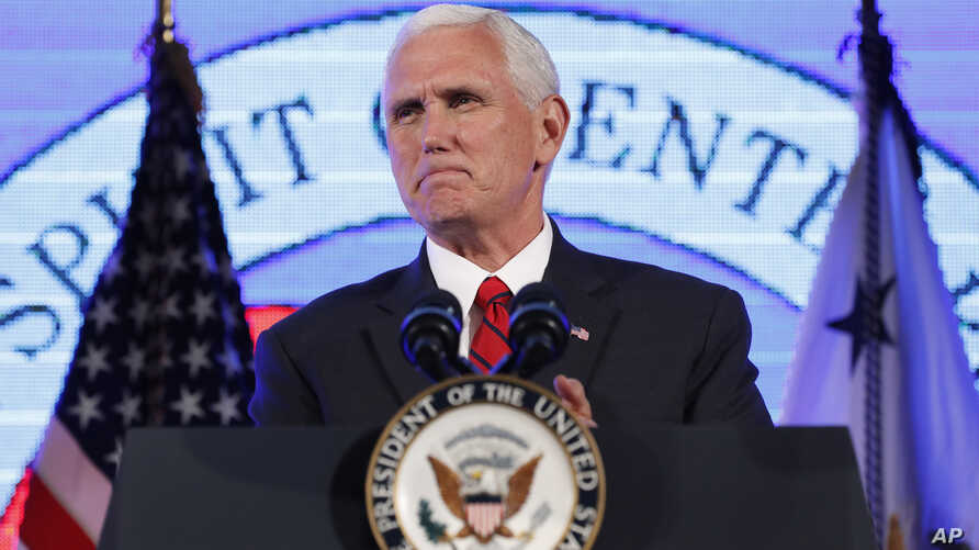 """Vice President Mike Pence pauses while speaking at the U.S. Chamber of Commerce during their """"Invest in America!"""" Summit, Thursday, May 18, 2017, in Washington."""
