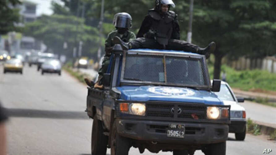 Police patrolling the streets of Conakry after violent confrontations between supporters of the two rivaling candidates, 24 Oct 2010