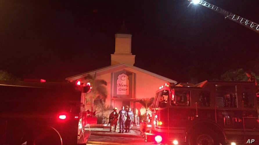 Firefighters work at the scene of a blaze at the Islamic Center of Fort Pierce, Fla., Sept. 12, 2016. (St. Lucie Sheriff's Office via AP)