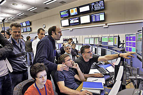 Scientists monitor the injection of proton and ion into the Large Hadron Collider, which is 100 meters underground near Geneva, Switzerland, 23 Oct 2009