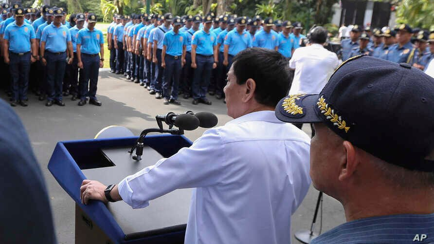 In this photo provided by the Presidential Photographers Division, Malacanang Palace, Philippine President Rodrigo Duterte speaks to erring policemen during an audience at the Presidential Palace grounds in Manila, Philippines, Feb. 9, 2017.