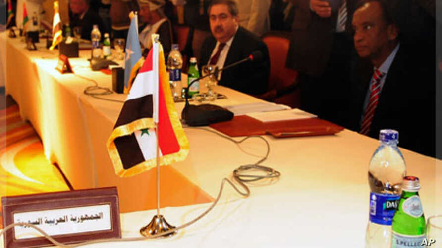 The seat of the Foreign Minister of Syria is seen empty during a meeting for Arab foreign ministers in Cairo to discuss the situation in Syria, November 24, 2011.