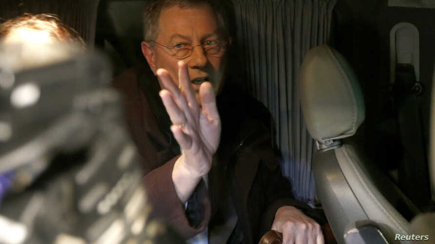 UN special envoy Robert Serry gestures as he leaves in a car in Simferopol, Ukraine, March 5, 2014.