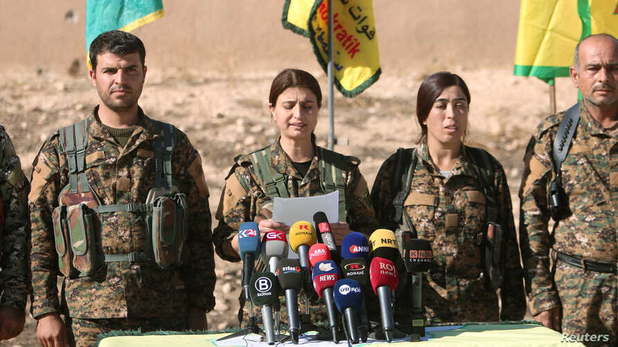 Syrian Democratic Forces (SDF) commanders attend a news conference in Ain Issa, Raqqa Governorate, Syria, Nov. 6, 2016.
