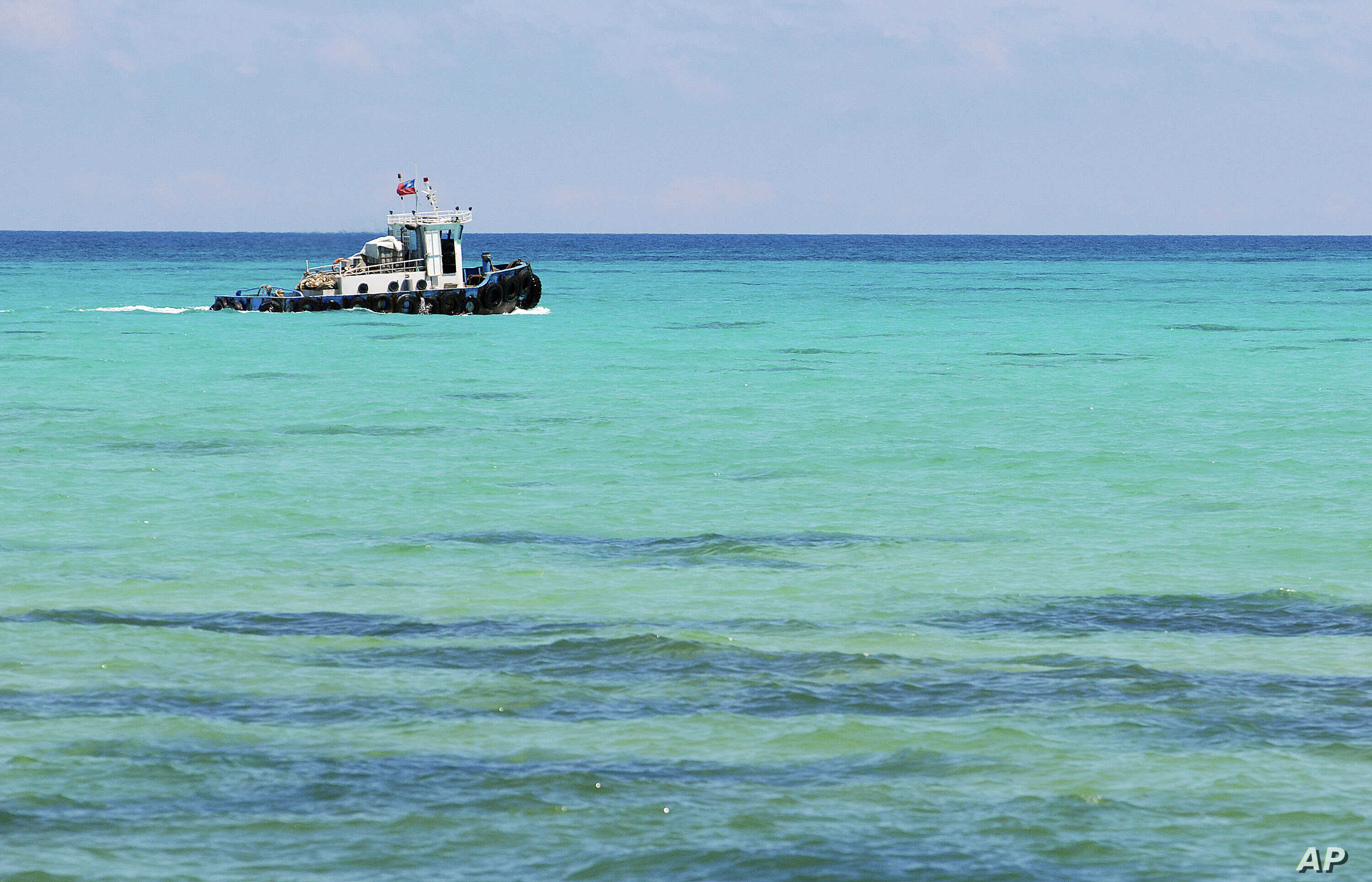 A boat of Taiwan's coast guard is seen off the Dongsha Island, on Wednesday July 23, 2008. Concrete pilings designed to prevent an invasion no longer dot this tiny Taiwanese islet's shoreline.