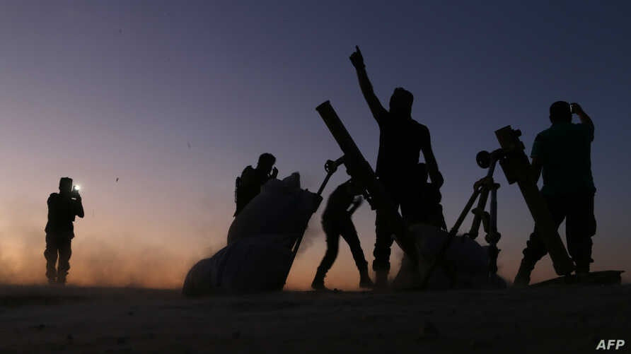 Fighters from the Free Syrian Army cheer and react as they fight against Islamic State group jihadists on the outskirts of the northern Syrian town of Dabiq, Oct. 15, 2016.
