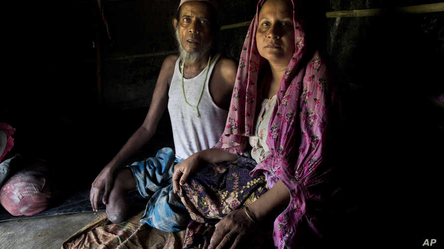 Rohingya Muslim man Sultan Mehmood, 62, and his wife Haseena Begum, 45, sit for a photograph inside their shelter near Balukhali refugee camp, Bangladesh. The couple stayed in their hometown when violence broke out last month in Myanmar. That decisio