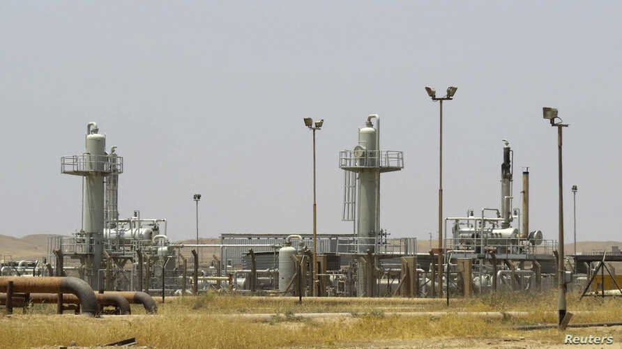 FILE - A view shows the Bai Hassan oilfield northwest of Kirkuk, July 12, 2014.
