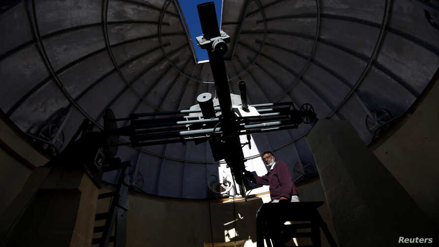 Devendran, a 55-year-old observer, positions the six-inch telescope at the Kodaikanal Solar Observatory, India, Feb. 6, 2017.
