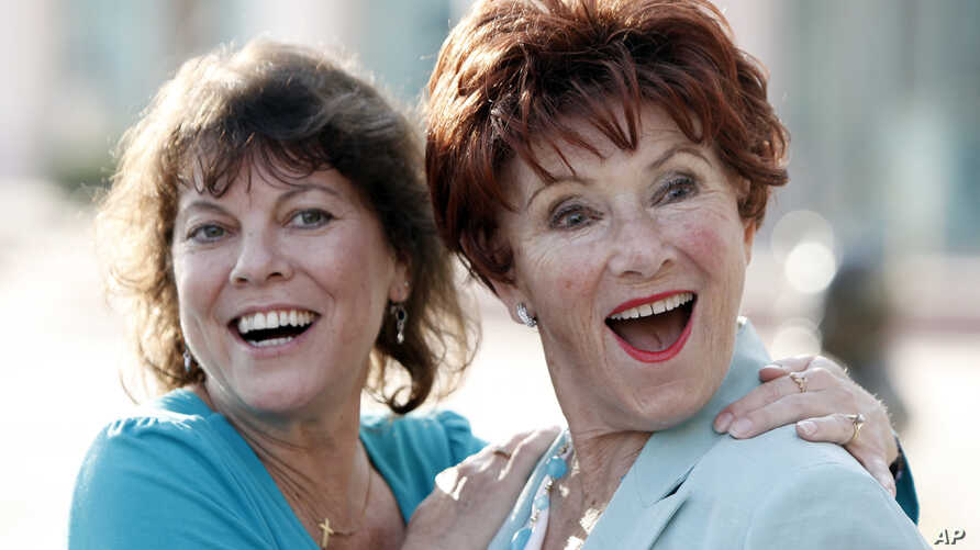 "FILE - Actresses Erin Moran (left) and Marion Ross played daughter and mother on ""Happy Days."" They are pictured, June 18, 2009, in North Hollywood. Moran died Saturday at age 56."