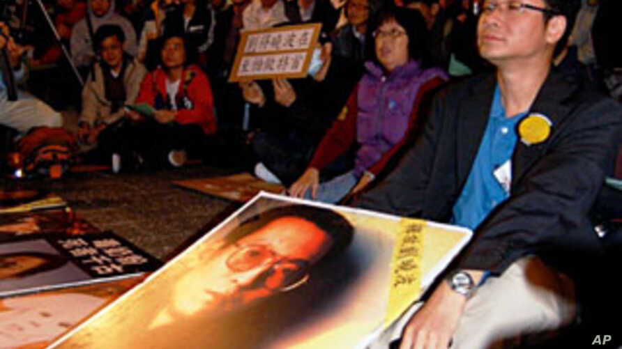 Hong Kong protesters demand the release of jailed Chinese dissident and Nobel Peace Prize winner Liu Xiaobo, 10 Dec 2010