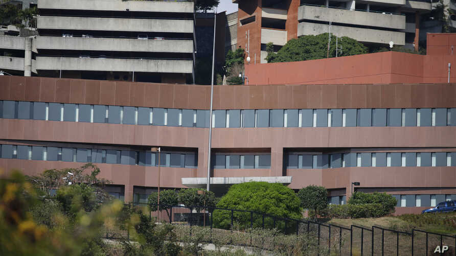 This photo show the facade of the U.S. Embassy and the flag pole without the American flag, in Caracas, Venezuela, March 14, 2019.