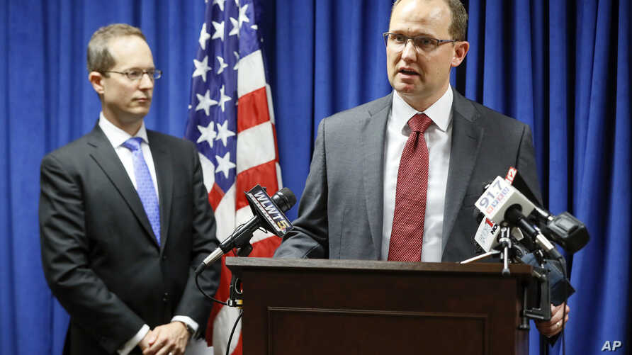 Herb Stapleton, Assistant Special Agent in Charge, FBI (R) speaks alongside U.S. Attorney Benjamin C. Glassman (L) during a news conference, Oct. 10, 2018, in Cincinnati.