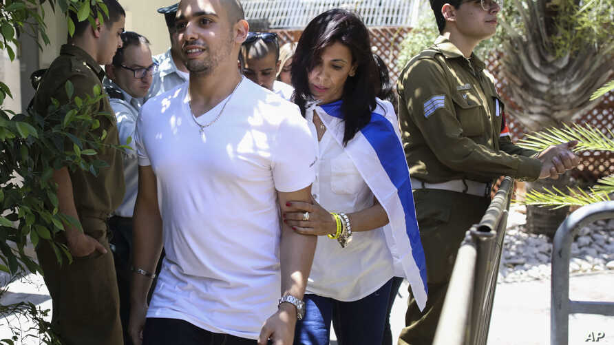 Elor Azaria escorted by his mother arrives to Israeli military court in Tel Aviv, Sunday, July 30, 2017.