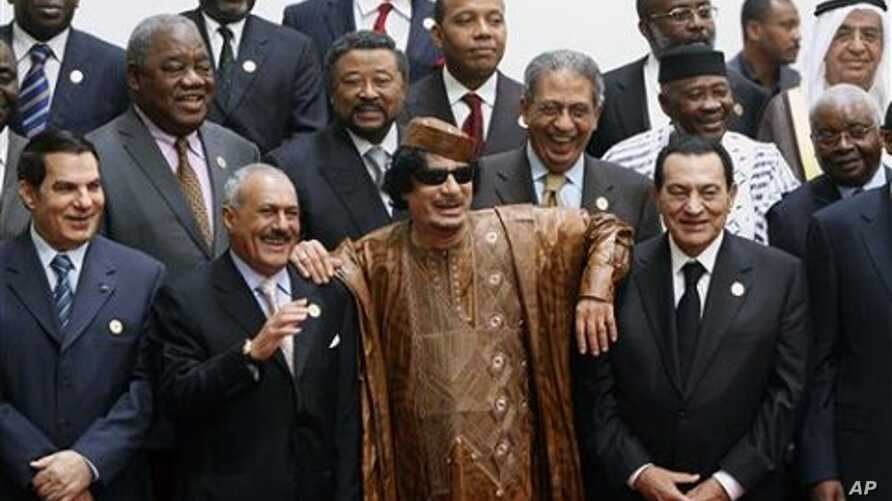 Libyan leader Moammar Gadhafi, centre, with Egyptian President Hosni Mubarak, right, and his Yemeni counterpart Ali Abdullah Saleh, centre left, during a group picture with Arab and African leaders during the second Afro-Arab summit in Sirte, Libya,