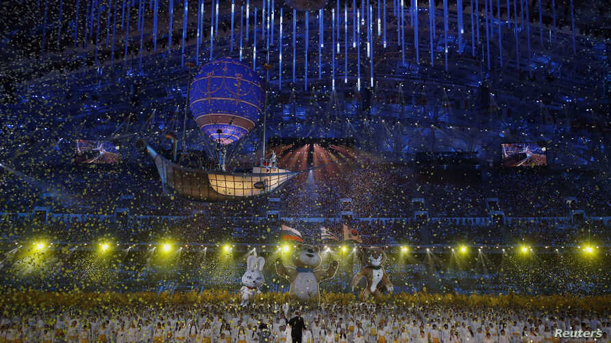 Confetti rains down at the end of the closing ceremony for the 2014 Sochi Winter Olympics, Feb. 23, 2014.