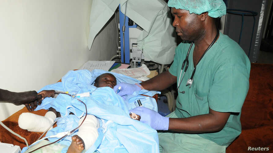 A boy who was injured in an attack by rebel gunmen on vehicles on the road connecting Yei town to the capital Juba receives treatment at a military hospital in Juba, South Sudan, Oct. 18, 2016.