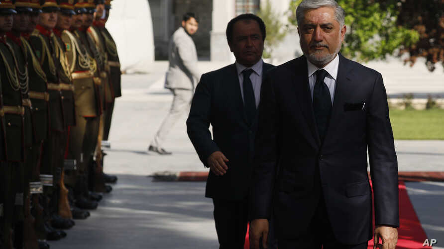 Afghanistan's Chief Executive Abdullah Abdullah, right, arrives to attend a meeting with President Ashraf Ghani and U.S. Defense Secretary James Mattis at the Presidential Palace in Kabul, Afghanistan , April 24, 2017.