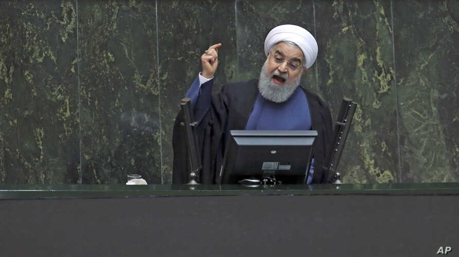 Iranian President Hassan Rouhani speaks in a session of the parliament while answering questions of lawmakers, in Tehran, Aug. 28, 2018.