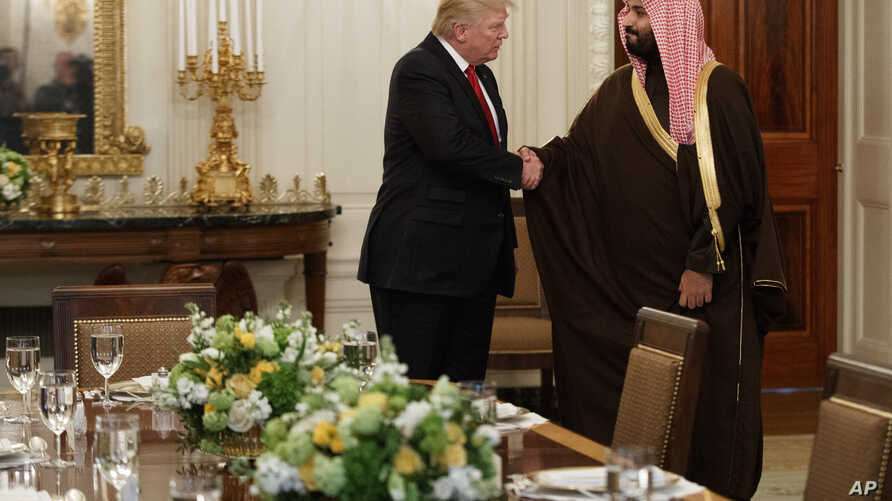 President Donald Trump shakes hands with Saudi Defense Minister and Deputy Crown Prince Mohammed bin Salman, Tuesday, March 14, 2017, in the State Dining Room of the White House in Washington.