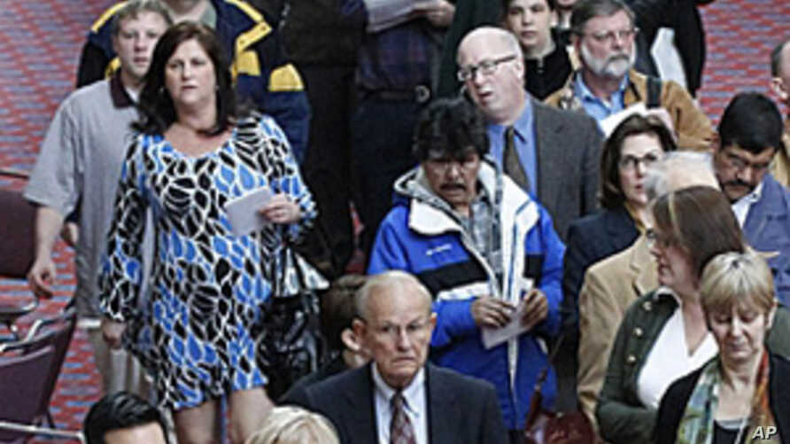 Job seekers stand in line during a Career Expo job fair, in Portland, Oregon, March 7, 2012.
