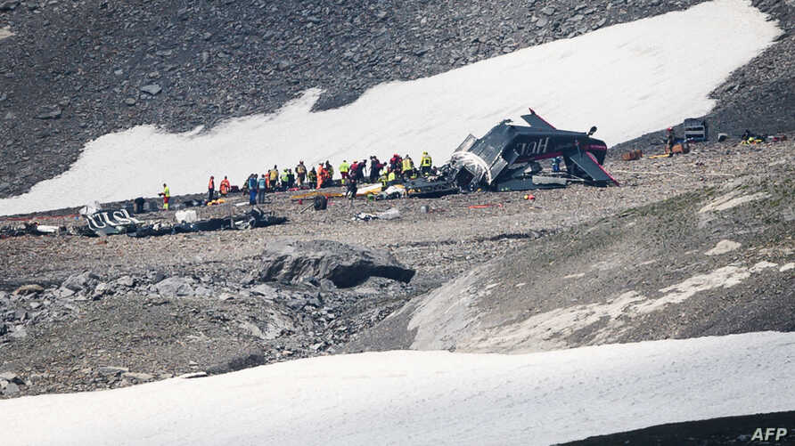 Accident investigators and rescue personnel work at the wreckage of a Junkers JU52 aircraft in Flims, Aug. 5, 2018, after it crashed into Piz Segnas, a 3,000-meter (10,000-foot) peak in eastern Switzerland.