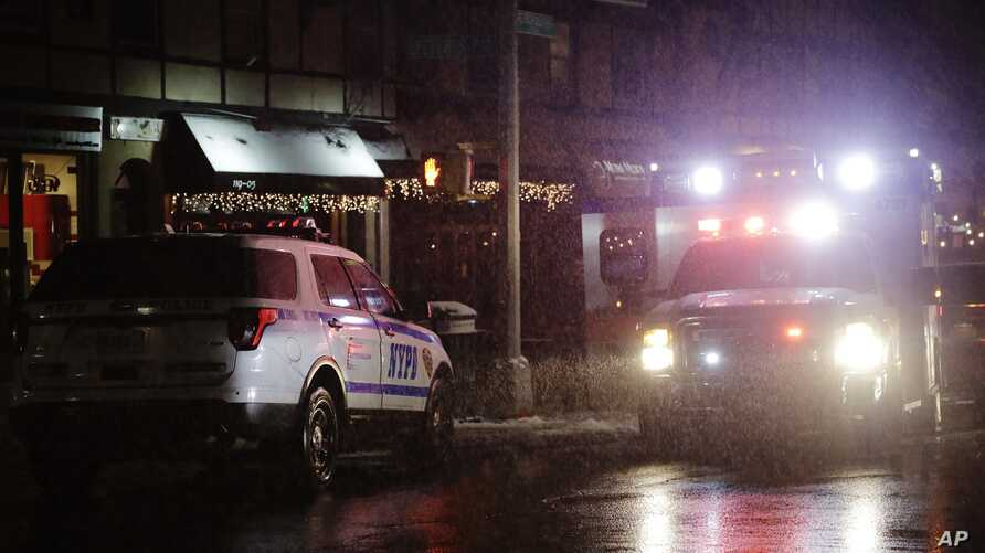 In this Feb. 20, 2019, photo, emergency vehicles respond in the Queens borough of New York.