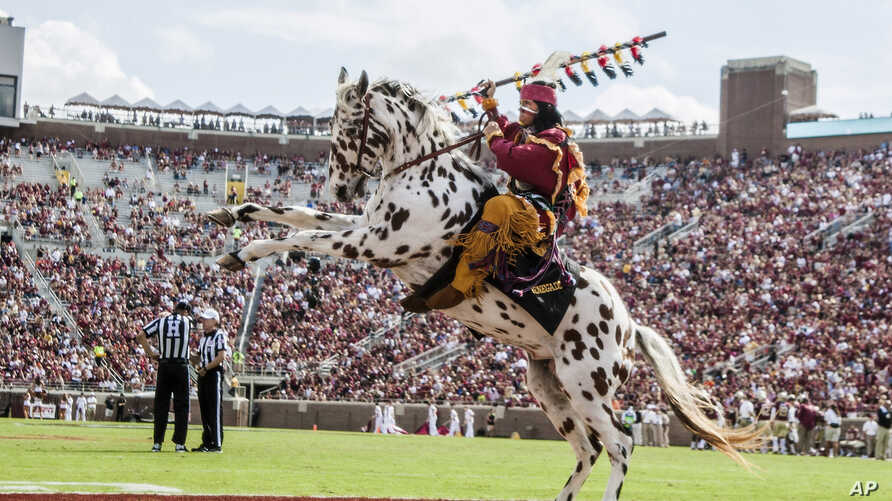 Florida State mascot Osceola riding the horse Renegade celebrates a touchdown in the second half of an NCAA college football game against Syracuse in Tallahassee, Fla., Oct. 31.