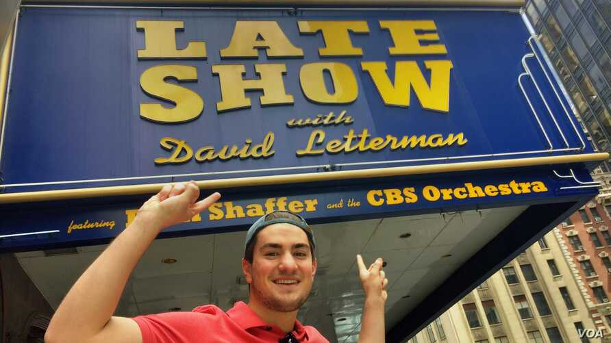Greg Contaldi, a lifetime Dave Letterman fan, outside the CBS Ed Sullivan Theater in Manhattan, hoping to get an audience ticket for the host's last show. (VOA Photo: Adam Phillips)