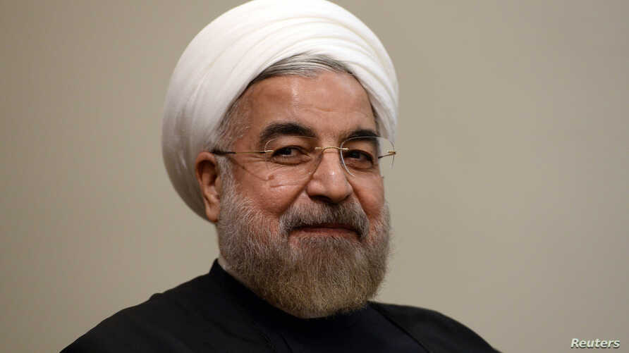 Iran's President Hassan Rouhani listens during a meeting with U.N. Secretary-General Ban Ki-moon on the sidelines of the U.N. General Assembly in New York, Sept. 23, 2014.