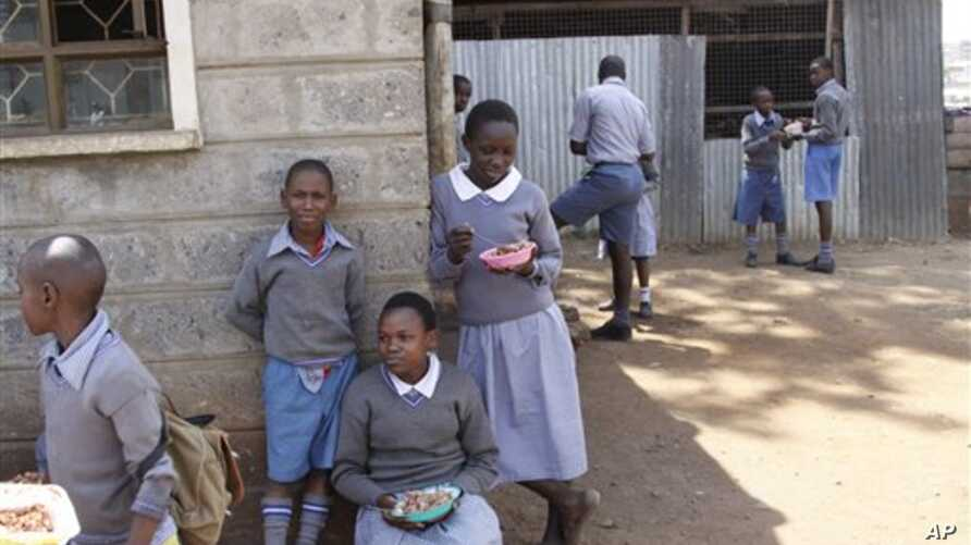 Pupils play during their lunch break at Mariakani Primary School in Nairobi, Kenya Monday, July 27, 2015. Mr. Obama announced during his visit to Kenya Sunday that Kenya would be part of PEPFAR's DREAMS project to protect adolescent girls from HIV.  ...