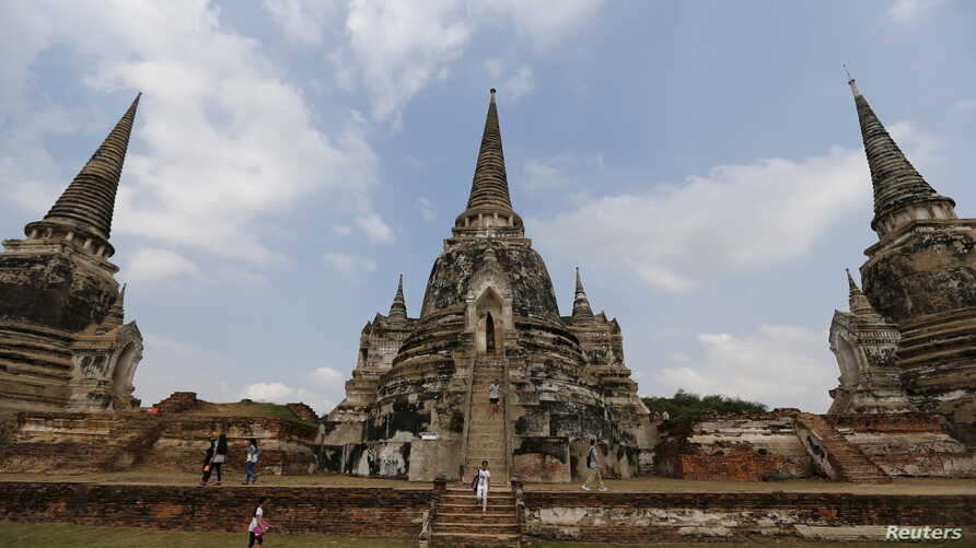 FILE - Tourists walk at the ruins of the ancient capital of Ayutthaya, Thailand, Dec. 25, 2015. International tourist arrivals in Thailand are expected to reach a record high in 2016, the tourism minister said on Jan. 6, 2016, after nearly 30 million