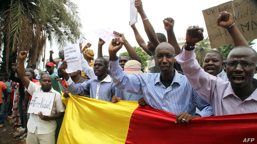Malian people take part in a demonstration in front of the French Ambassy in Bamako on May 19, 2014, to denounce the occupation by rebels of Kidal, 1,500 kilometres (900 miles) northeast of the capital Bamako, and accuse France of complicity with arm