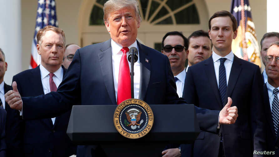 U.S. President Donald Trump acknowledges U.S. Trade Representative Robert Lighthizer and White House senior adviser Jared Kushner as he delivers remarks on the United States-Mexico-Canada Agreement (USMCA) during a news conference in the Rose Garden