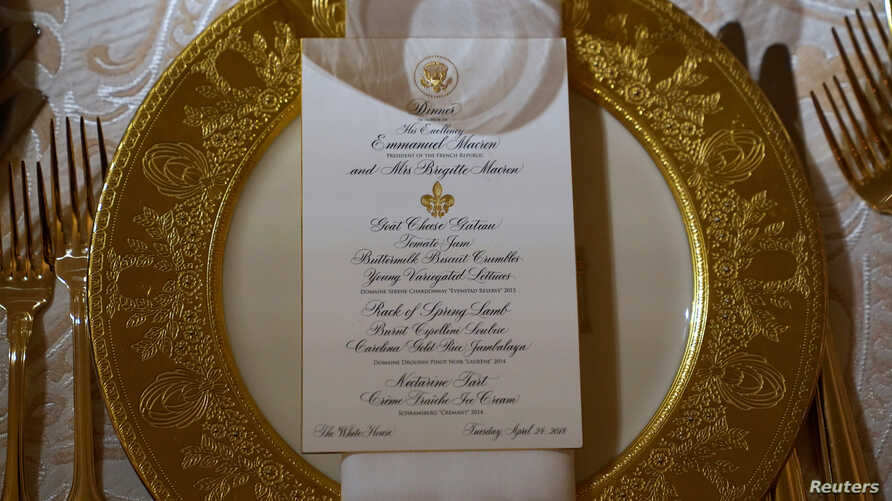 A place setting for the State Dinner for French President Emmanuel Macron is shown in the State Dining Room of the White House in Washington, U.S., April 23, 2018.