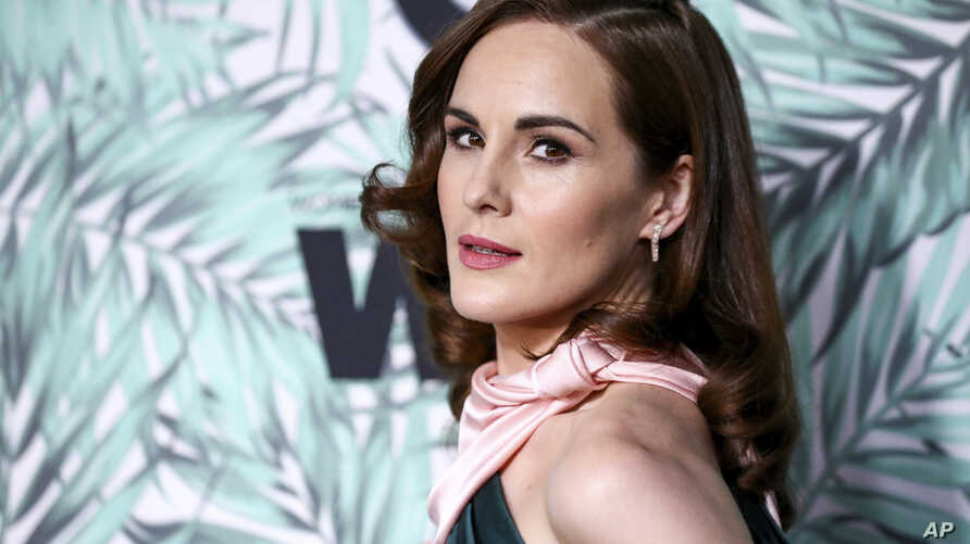 "FILE - In this Feb. 24, 2017, file photo, Michelle Dockery arrives at the 10th Annual Women in Film Pre-Oscar Cocktail Party at Nightingale Plaza in Los Angeles. Filming has begun for the ""Downtown Abbey"" movie. Dockery, who plays Lady Mary in the gl"