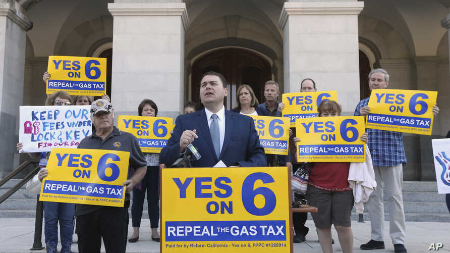 FILE - Carl DeMaio, who is leading the Proposition 6 campaign to repeal a recent gas tax increase, discusses a ballot measure he is proposing to provide money for road repairs and eliminate high-speed rail in Sacramento, Calif.,  Sept. 25, 2018.