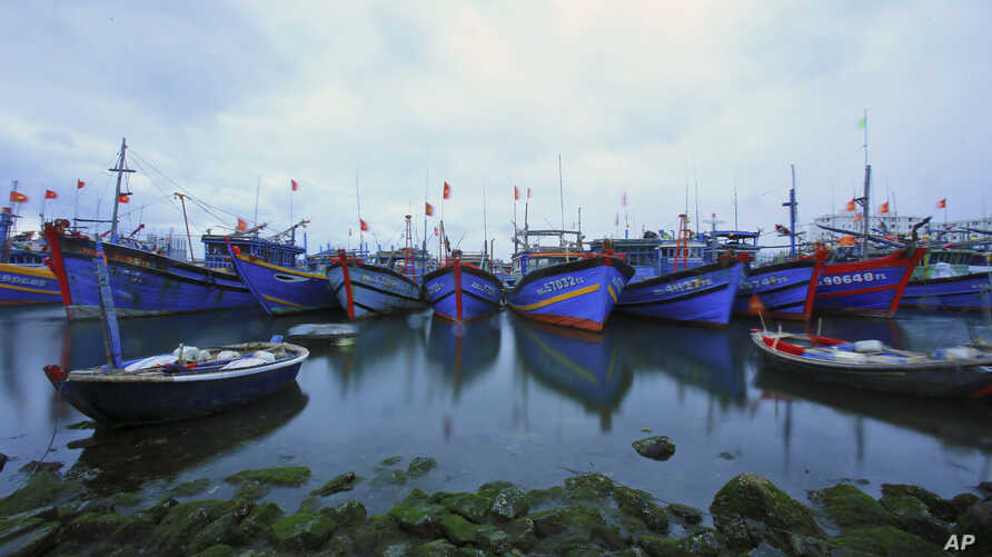 FILE - Fishing boats are docked in Tho Quang port, Danang, Vietnam, March 26, 2016. Fishermen from around the South China Sea tell stories of contending with bandits and coast guards.