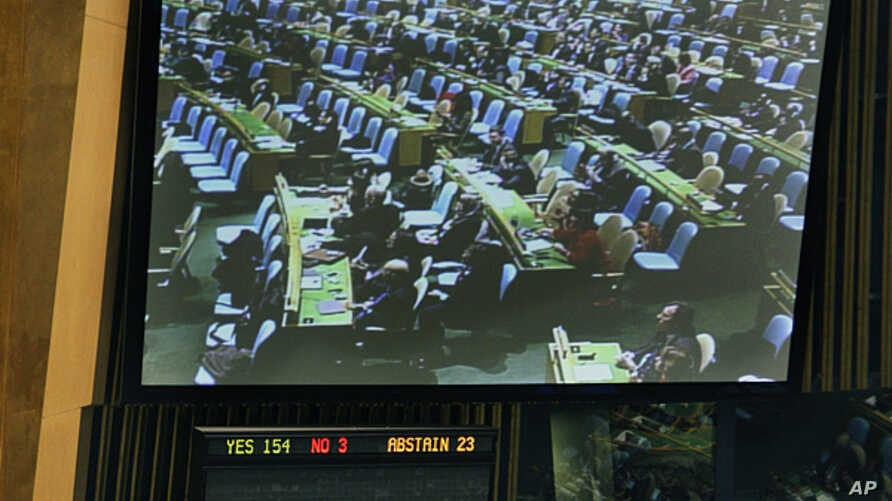 The U.N. General Assembly vote approving the first U.N. treaty regulating the international arms trade, April 2, 2013.