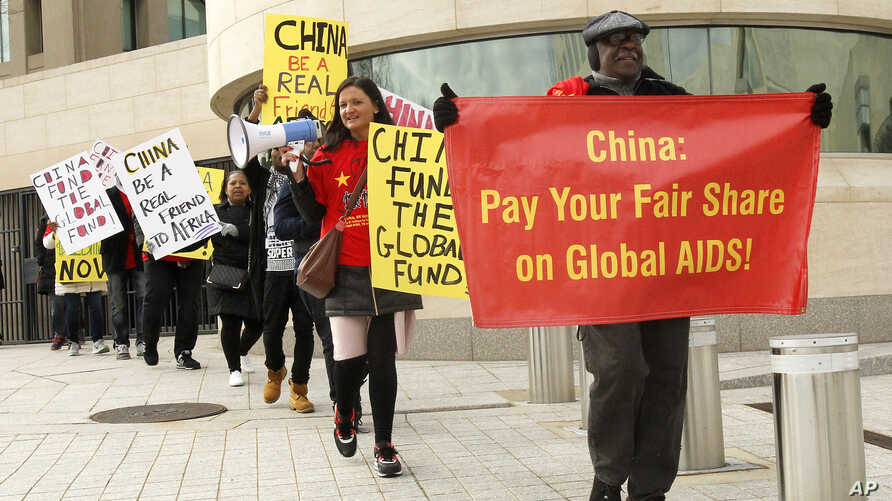 "Advocates from the AIDS Healthcare Foundation and other community organizations demonstrate outside the Chinese Embassy, Jan. 28, 2017 in Washington, DC. The demonstration is part of the ""Fund the Fund"" advocacy campaign, which calls on China, the wo"