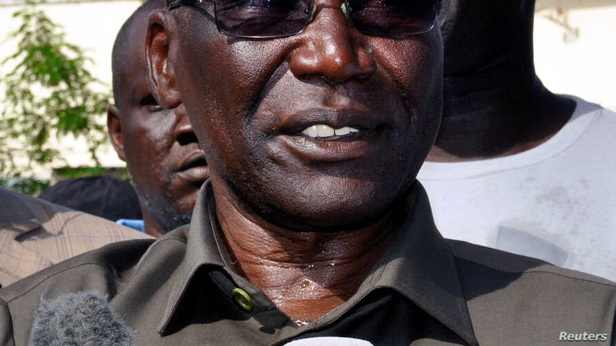 FILE - South Sudan's former army chief, Paul Malong, talks to reporters in Juba, May 13, 2017.
