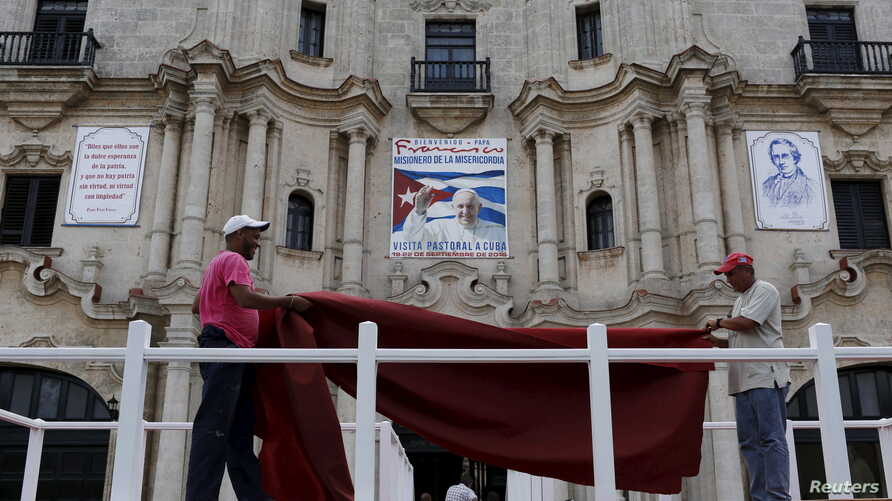 Workers do the final touches to one of the podiums near Havana's cathedral, that will be used during visit of Pope Francis, Cuba, Sept. 17, 2015.