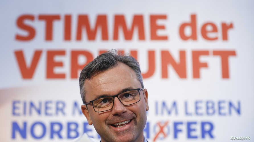 Presidential candidate Norbert Hofer presents his new electoral posters during a news conference in Vienna, Austria, April 29, 2016.