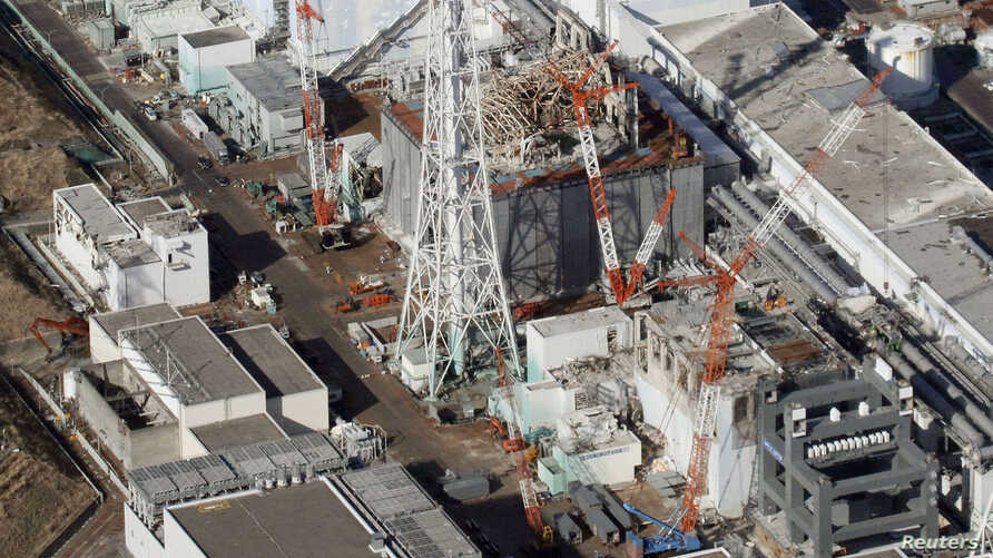 An aerial view shows (from top to bottom) No.1, No.2, No.3 and No.4 reactor buildings at Tokyo Electric Power Co. (TEPCO)'s tsunami-crippled Fukushima Daiichi nuclear power plant in Fukushima Prefecture, March 11, 2013.