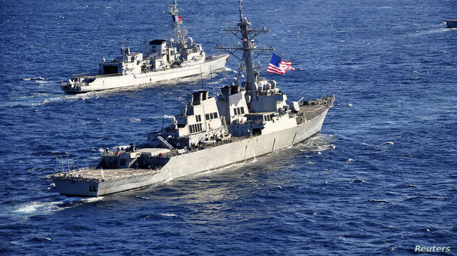 The guided-missile destroyer USS Barry (DDG 52), (front) pulls into formation with French Marine Nationale anti-submarine frigate Jean de Vienne (D 643) during Exercise Proud Manta 2013 (POMA 13) in this Feb. 26, 2013 U.S. Navy handout photo.