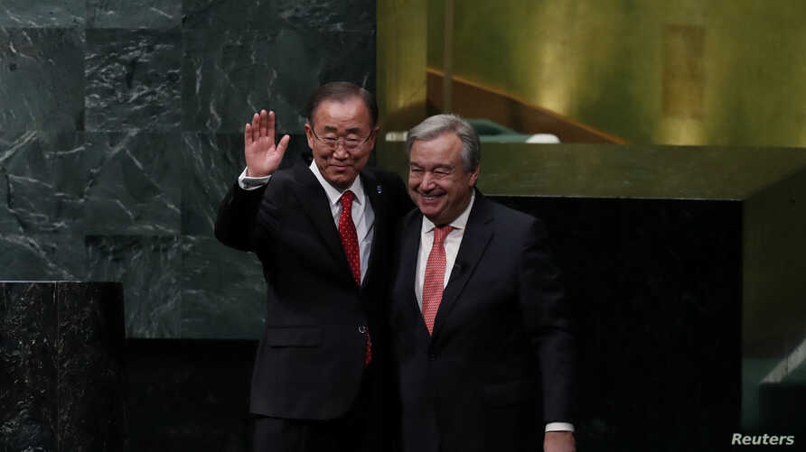 United Nations Secretary-General Ban Ki-moon (left) and Secretary-General-designate Antonio Guterres stand together after the swearing-in ceremony at UN headquarters in New York, Dec. 12, 2016.