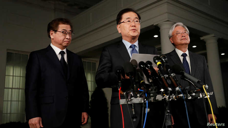 South Korea's National Security Office head Chung Eui-yong, center, Cho Yoon-je, the South Korean Ambassador to the U.S., right, and National Intelligence Service chief Suh Hoon, left, make an announcement about North Korea and the Trump administrati...