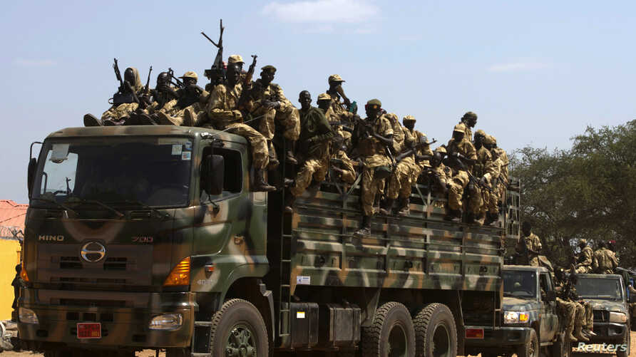 SPLA soldiers drive in a truck in Juba December 21, 2013. African mediators sought on Saturday to meet rivals to South Sudan's president in a bid to end fighting that threatens to drag the world's newest country into an ethnic civil war. REUTERS/Stri