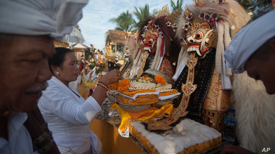 FILE - Balinese Hindu prepare for a procession during a Melasti purification ceremony ahead of the holy day of Nyepi, on Purnama Beach, Gianyar, Bali, Indonesia March 14, 2018 in this photo taken by Antara Foto.