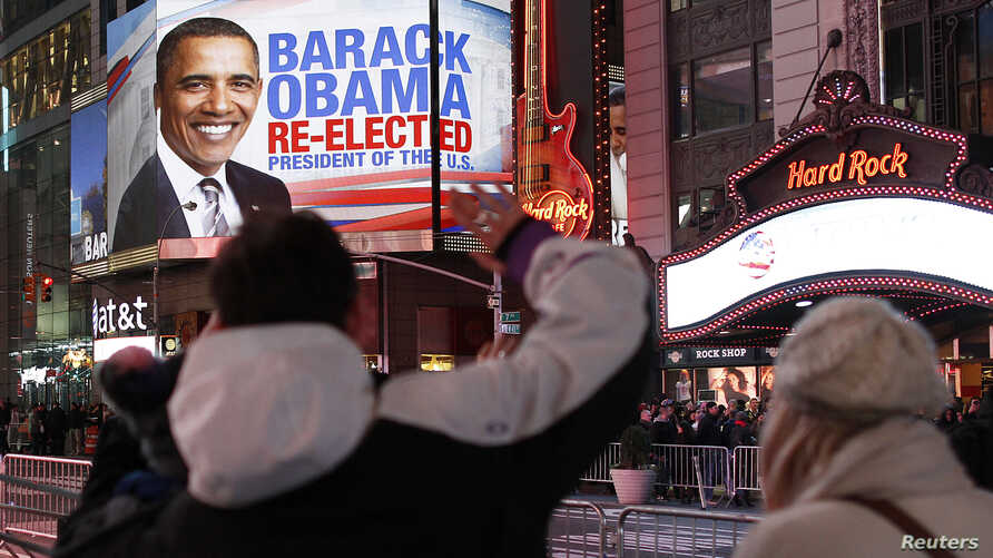 People celebrate in Times Square after Barack Obama was projected to win the U.S presidential election in New York November 6, 2012.